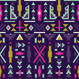 Seamless colorful aztec pattern. Dark background. Royalty Free Stock Images
