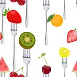 Seamless Colorful Background made of fruits on the forks Royalty Free Stock Images