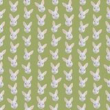 Seamless colorful background made of  heads of rabbits in flat d Stock Photos