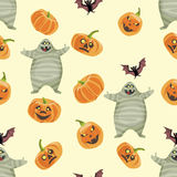 Seamless colorful background made of pumpkin, mummy and bat Stock Images