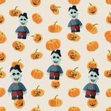 Seamless colorful background made of pumpkin and zombie Stock Photos
