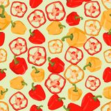 Seamless colorful background made of slices and whole peppers in Stock Image