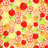 Seamless colorful background made of slices and whole peppers in Stock Photography