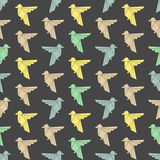 Seamless colorful background made of triangle birds Stock Photos