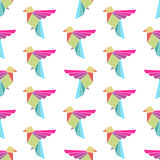Seamless colorful background made of triangle birds Stock Image