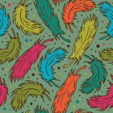 Seamless colorful background with plumes. Decorative doodle pattern with feathers Stock Images