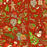Seamless Colorful Christmas Pattern. Christmas tree and Christmas baubles, gifts, candy canes, snowman, swirls, gingerbread man, deer, bells and ribbons, stars Royalty Free Stock Photos