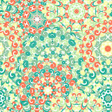 Seamless colorful ethnic pattern with mandalas. Seamless colorful ethnic pattern with mandalas in oriental style. Round doilies with green, orange and yellow Stock Photos
