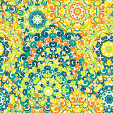 Seamless colorful ethnic pattern with mandalas in oriental style. Round doilies with green, yellow, orange curls and. Swirls weaving in arabesque traditional Royalty Free Stock Image