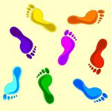 Seamless colorful footprints background. vector Stock Images