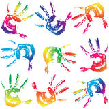 Seamless colorful hand prints background. Set vector human hand prints isolated on a white Stock Photos