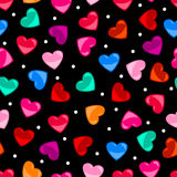 Seamless colorful heart shape pattern over black Royalty Free Stock Image