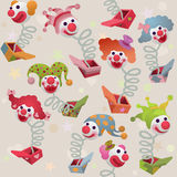 Seamless colorful jack in the box puppets. Seamless pattern - colorful jack in the box puppets popping out of boxes Stock Images