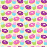 Seamless colorful pattern with donuts and cupcakes on yellow background. Seamless colorful pattern with donuts and cupcakes on white background. Vector Stock Photos