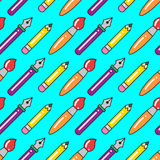 Seamless colorful pattern with pens, brushes and pencils. Royalty Free Stock Images