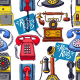 Seamless colorful vintage phones Stock Image