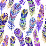 Seamless colorful watercolor pattern with bright feathers Royalty Free Stock Image