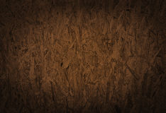 Seamless compressed light brown chipboard. Stock Photography