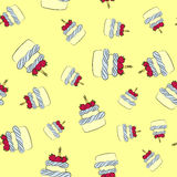 Seamless cream cake pattern with yellow background. Seamless cream cupcake and cake pattern with yellow background Stock Photo