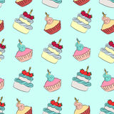 Seamless cream cupcake and cake pattern. With blue background Royalty Free Stock Image