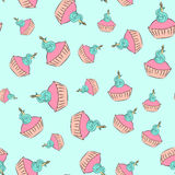 Seamless cream cupcake pattern with blue background Royalty Free Stock Photos