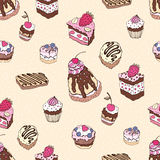 Seamless cupcake pattern. Yummy cute background. Hand drawn vector pattern Stock Photos