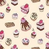 Seamless cupcake pattern Stock Photos
