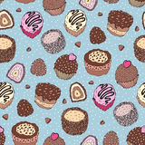 Seamless cupcake pattern. Yummy cute background. Hand drawn vector pattern Royalty Free Stock Images