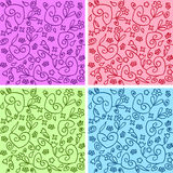 Seamless curly patterns. A set of 4 seamless different colors backgrounds Stock Image