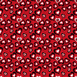 Seamless cute bright ornamental pattern with hearts on a red background. Stock Photo