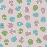 Seamless cute cartoon owls birds pattern background. Royalty Free Stock Images