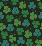 Seamless cute pattern with clover, trefoil  Endless background texture for wallpapers, packaging, textile, crafts Royalty Free Stock Photos