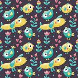 Seamless cute pattern made with dog, birds, flowers, paw, trace, plants, berries Stock Images