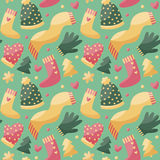 Seamless cute winter christmas pattern made with  clothes, hat, scarf, gloves, mittens, heart,  tree Stock Photo