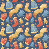 Seamless cute winter christmas pattern made with  clothes, hat, scarf, gloves, mittens, heart,  tree Royalty Free Stock Photo