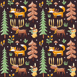 Seamless cute winter christmas pattern made with fox, rabbit, mushroom, moose, bushes, plants, snow, tree Royalty Free Stock Images