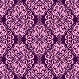 Seamless damask floral Wallpaper in pink-violet colors. Stock Image