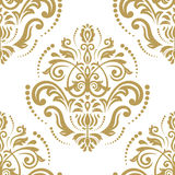 Seamless Damask Pattern. Traditional classic orient ornament. Golden and white pattern Royalty Free Stock Images