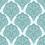 Seamless damask Wallpaper with blue Ornament. Stock Photos