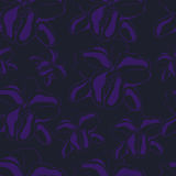 Seamless dark background with purple silhouettes of orchids Stock Photos