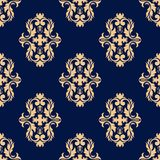 Seamless dark blue pattern with golden wallpaper ornaments Royalty Free Stock Image