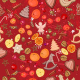 Seamless dark red with traditional Christmas elements - cookies and fruits. Stock Image