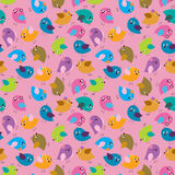 Seamless decorative background of multi-colored cute birds Stock Image