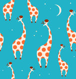 Seamless decorative pattern with funny giraffes. Royalty Free Stock Photo