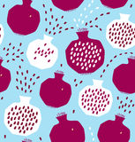Seamless decorative pattern with pomegranates. Royalty Free Stock Photo