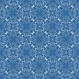 Seamless decorative vector tile with white filigree lace patterns on blue background. In art nouveau style. Vintage background with geometric regular ornament Stock Images
