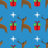 Seamless deer pattern. Deer and gift on a blue background.  It can be used as a seamless texture Royalty Free Stock Image