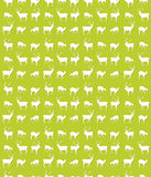 Seamless deer pattern. Seamless repeating pattern design with deer silhouettes Royalty Free Stock Photo