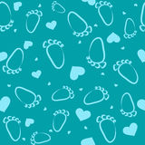 Seamless depicting traces of feet and hearts in a cartoon, child Stock Image