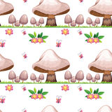 Seamless design with mushrooms and butterflies Royalty Free Stock Image